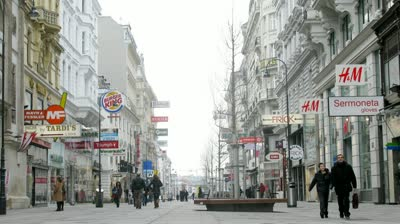 stock-footage-vienna-feb-timelapse-view-tourists-go-on-kartner-strasse-and-on-pedestrian-crossing-on-feb